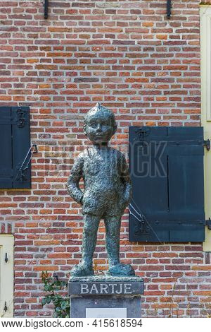 Assen, Netherlands - May 30, 2020: Statue Of Little Boy Bartje In Assen, Netherlands