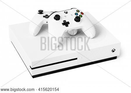 Moscow, Russia - April 18, 2019: Wireless gamepads and Xbox console - isolated on white background.