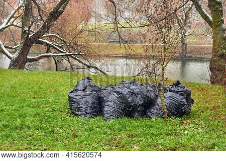 A Bag Of Plastic Garbage Is Lying In The Park On The Grass, Nature Pollution, Garbage And Nature, Su