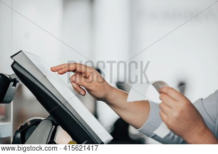 Young Saleswoman Doing Process Payment On Touchscreen Pos, Counting Sale In The Cash Register, Finan