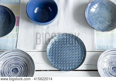 Empty Ceramic Tableware. Ceramic Plates On Wooden Surface. Overview Empty Food Table With Tableware.