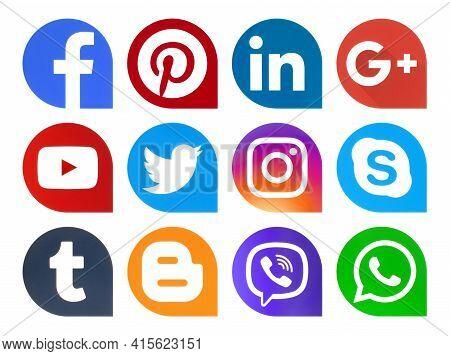 Kiev, Ukraine - February 26, 2021: Popular Social Media Icons Pointers Printed On Paper: Facebook, T