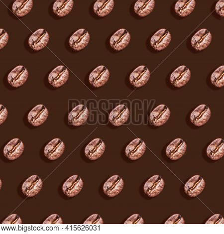 Roasted Brown Coffee Beans Pattern On Brown Background With Hard Shadow. Taste Energy Brown Morning