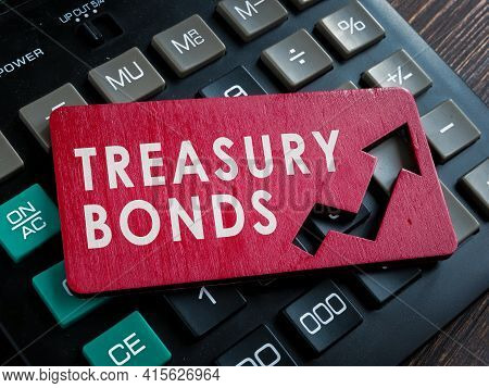 Treasury Bonds Words On The Red Plate And Calculator.