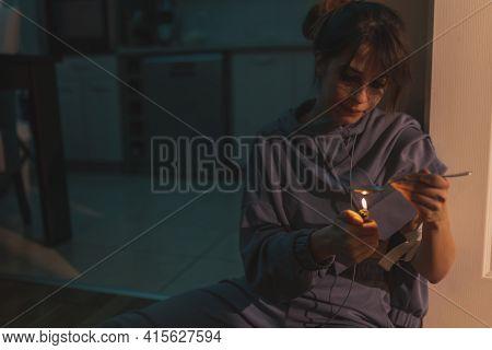 Female Drug Addict Sitting On The Floor In The Dark, Preparing Next Intravenous Cocaine Dose, Using
