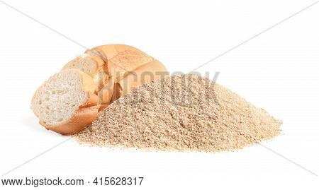 Pile Of Fresh Bread Crumbs And Sliced Loaf On White Background