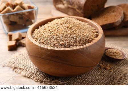 Fresh Breadcrumbs In Bowl On Wooden Table