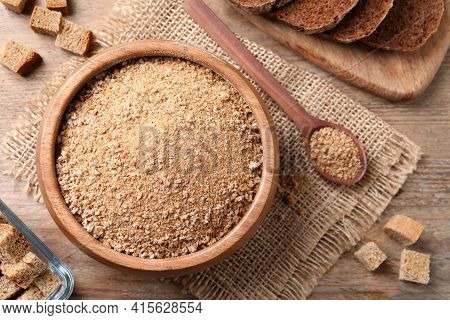 Fresh Breadcrumbs On Wooden Table, Flat Lay