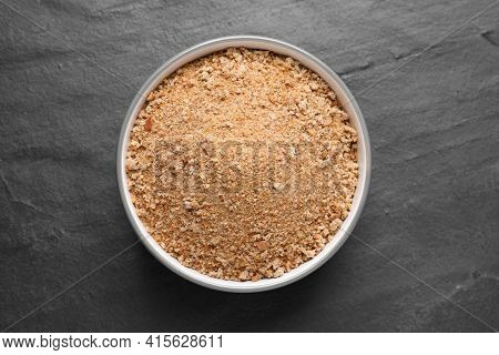 Fresh Breadcrumbs In Bowl On Black Table, Top View