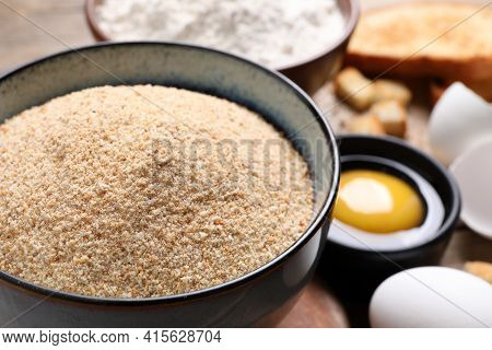 Fresh Breadcrumbs And Egg On Table, Closeup