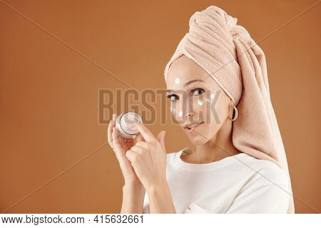 Beautiful Young Woman Applying Rejuvenating Cream Enriched With Vitamins After Taking Night Bath, Is