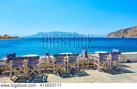 Aegina Island in Greece. Open air cafe by the sea in Perdika village