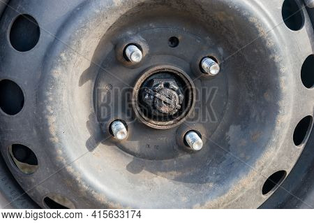 Bolts With Unscrew Nuts From A Car Wheel.