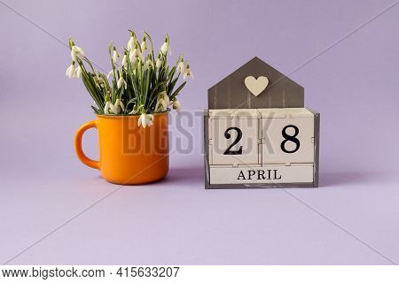 Calendar For April 28: Cubes With The Number 28, The Name Of The Month Of April In English, A Bouque