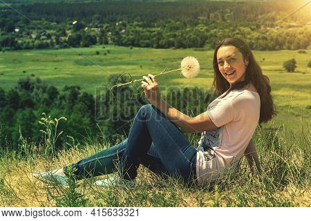 Happy, Beautiful Middle-aged Woman With Long Hair On The Background Of A Summer Field. Healthy Lifes