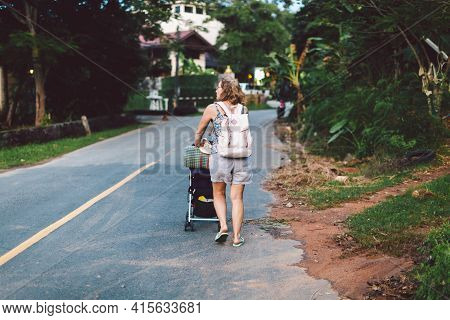 Rear View Mother Strolling With Toddler By Countryside The Street Journey With Kid. Every Day Of Mum