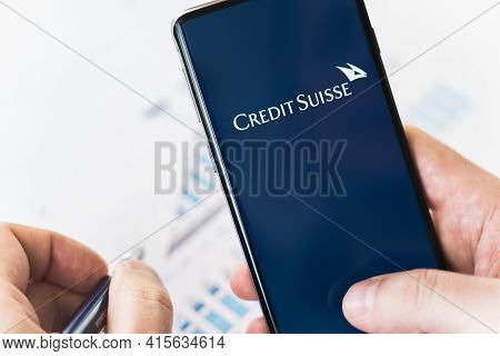 Russia Moscow 29.03.2021 Mobile Phone With Logo Of Credit Suisse Swiss Bank.investment Finance Compa