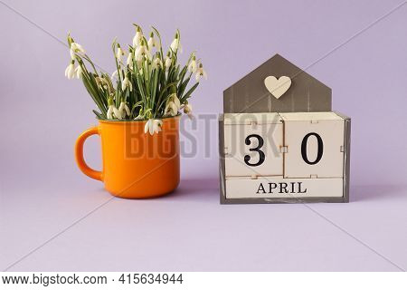 Calendar For April 30: Cubes With The Number 30, The Name Of The Month Of April In English, A Bouque