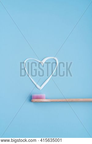 Eco-friendly Trendy Bamboo Toothbrush. Popular Toothbrushes. Hygiene Trends. Top View With Toothpast
