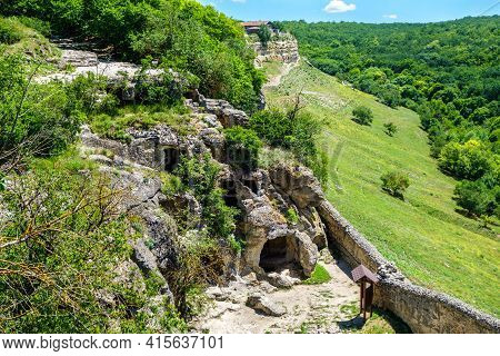 Panorama Of Residential Caves Inside Ancient City Chufut Kale, Bakhchisaray, Crimea. Also There Are