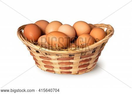 Chicken Eggs In Basket Isolated On White Background. Close Up