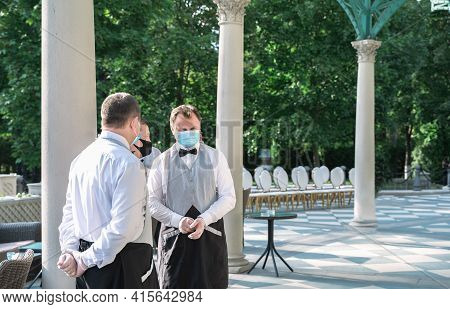 Russia Moscow 12.09.2020 Waiters In Masks,gloves,vests Serving Wedding Patry,holiday.protective Meas