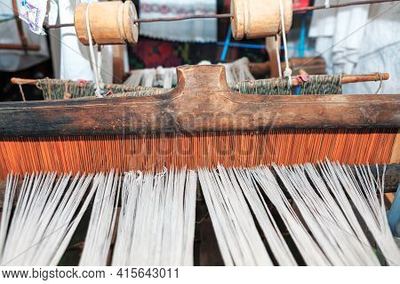 Ancient Loom For Making Carpets . Manufacturing Of Weaving Cloth And Tapestry