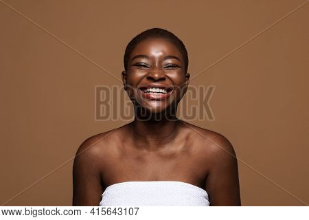 Self Acceptance. Laughing African American Woman With Short Hair And Perfect Skin