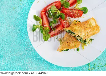 Omelette Rolls On A Plate. Homemade Fried Omelet Rolls With Chopped Greens. Healthy Low Carb Recipe.