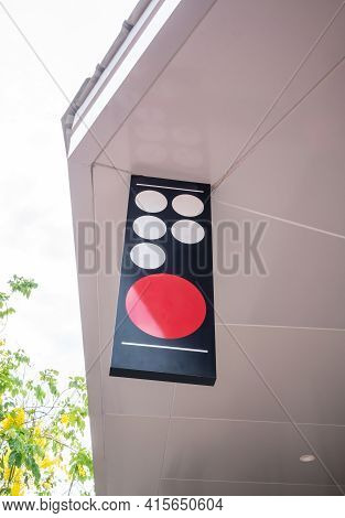 Blank Outdoor Sign Hanging From White Ceiling In Front Of Shop Or Restaurant. Mock Up Signage.