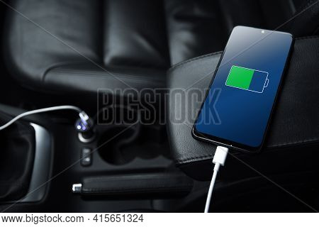 Mobile Phone ,smartphone, Cellphone Is Charged ,charge Battery With Usb Charger In The Inside Of Car