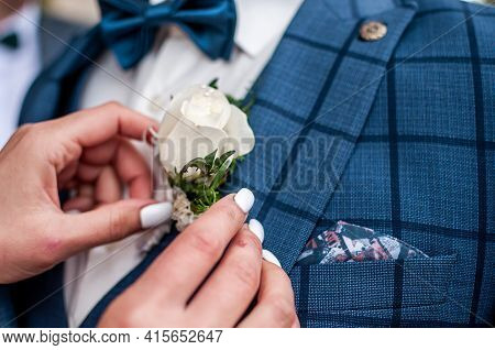 Bride Wearing Bonbonniere On The Grooms Jacket