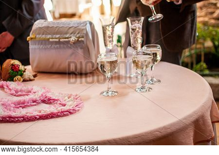 Glasses Of Champagne And White Box On The Pink Table