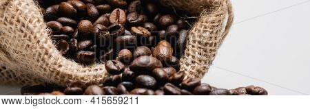 Close Up Of Hessian Sack Bag With Roasted Coffee Beans Isolated On White, Banner.