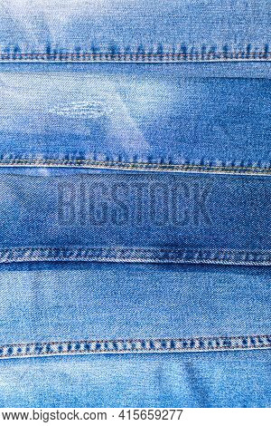 Denim Texture, Jeans In A Line, Vertically Background Of Variety Of Comfortable Casual Pants And Clo