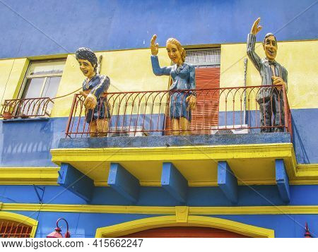 Buenos Aires, Argentina - January 26, 2015: Statues Greet From A Balcony The Tourists Visit  Caminit