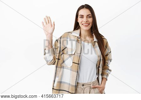 Friendly Stylish Woman Waving Hand And Saying Hello, Greeting You, Say Hey Whats Up, Meeting People