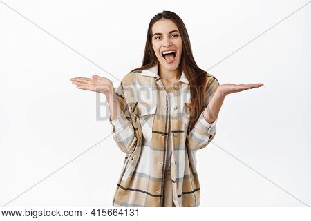 Nothing Here. Laughing Smiling Woman Shrugging, Showing Empty Hands And Looking Pleased, Fool Around