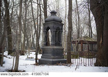 Black Obelisk In Winter Cemetery Among Leafless Trees - Smolenskoe Lutheran Cemetery, Russia, Saint