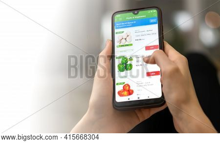 Mogilev, Belarus-march 23, 2021: Woman Orders Fresh Vegetables Through A Mobile Phone App Close-up W