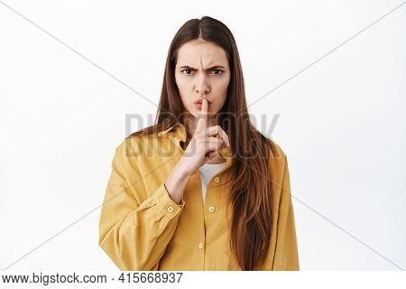 Shush, Be Quiet. Serious Bossy Girl Hushing, Tell To Keep Mouth Shut, Taboo Gesture, Asking For Sile