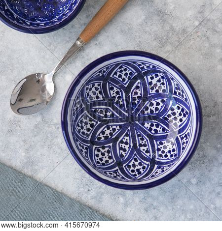 Decorative Ceramic Plate With Blue And White Colors, Painted Plate On Background, Closeup, Top View.