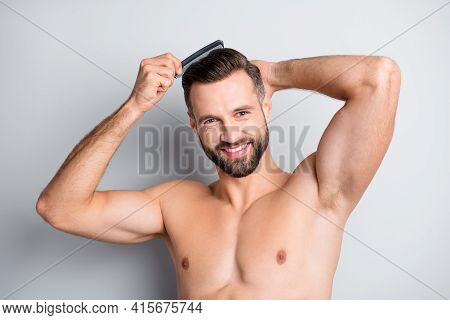 Photo Of Young Cheerful Stubble Guy Happy Positive Smile Brush Hair Hairdo After Shower Use Gel Isol