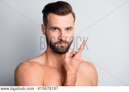 Close-up Portrait Of Attractive Nude Guy Holding On Finger Eye Lense Isolated Over Light Grey Pastel