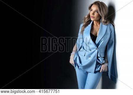 Stylish Blond Woman On Black And White Background In Blue Jacket