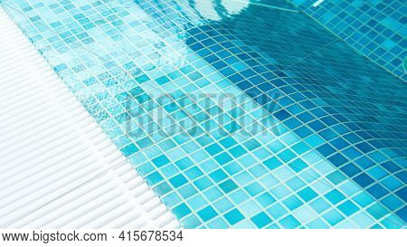 Swimming Pool Top View Close-up. Pool Water Surface Background With Copy Space. Texture Of Square Mo