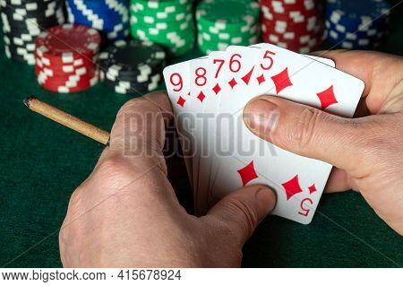 Poker Cards With Flush Combination. Close Up Of A Gambler Hand Is Holding Playing Cards In Poker Clu