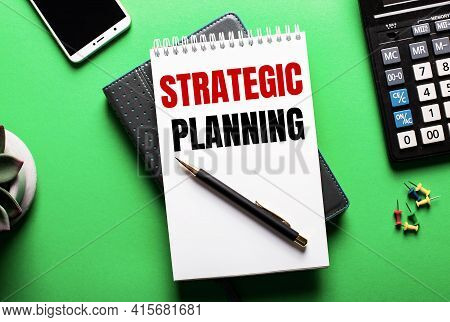 On A Green Background - A Telephone, A Calculator And A Diary With The Inscription Strategic Plannin