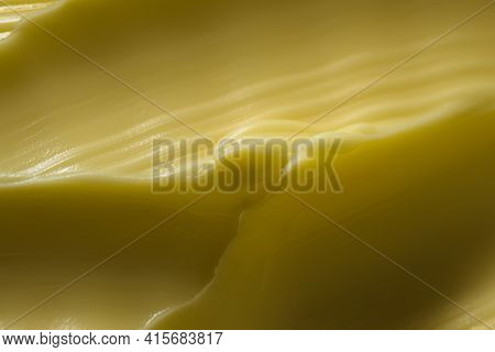 Super Macro Wavy Margarine Pattern. A Common Kitchen Ingredient That Is Often Touted As A Healthier