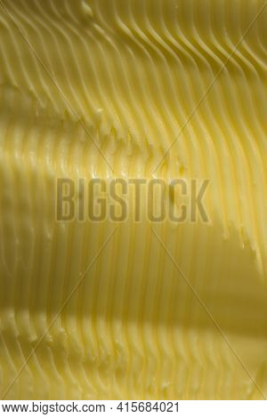 Vertical Food Texture Image. Full Frame Margarine, Textured Into Wavy Ridges Using A Knife. Commonly